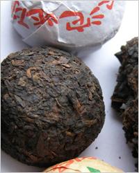 Прессованный китайский черный чай пуэр